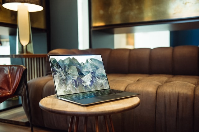 A laptop in a lounge room